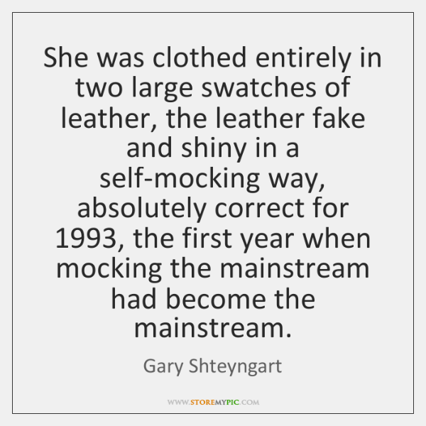 She was clothed entirely in two large swatches of leather, the leather ...