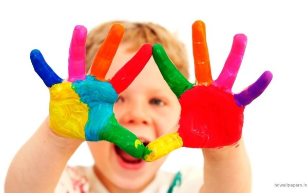 Cute baby with colorful hands
