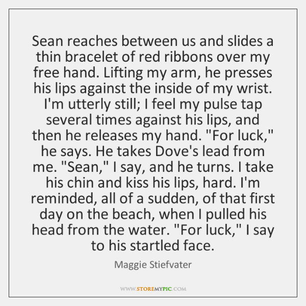 Sean reaches between us and slides a thin bracelet of red ribbons ...