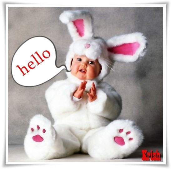 Cute baby in bunny costume saying hello