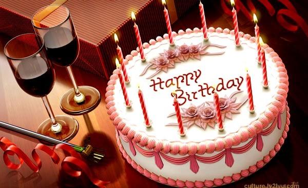 Happy birthday cake with wine glasses