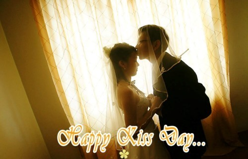 Happy kiss day bride and groom