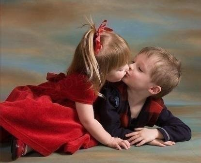 Sweet little boy and girl kissing each other happy kiss day