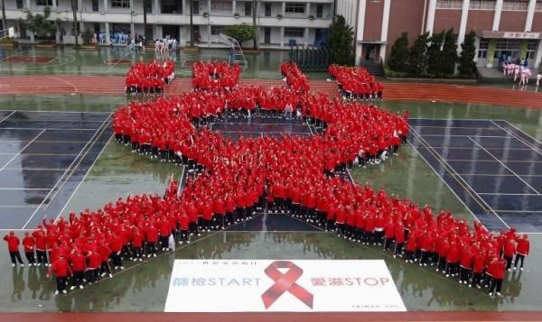 World aids day people gathered to make huge ribbon