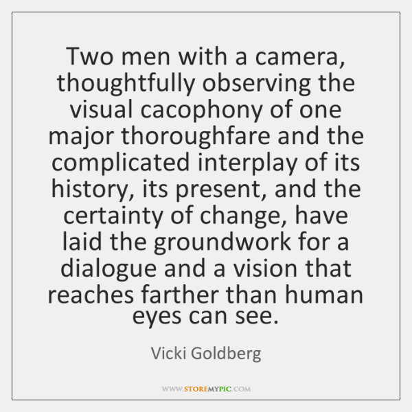 Two men with a camera, thoughtfully observing the visual cacophony of one ...