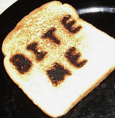 Bite me wrote on cooked bread in pan