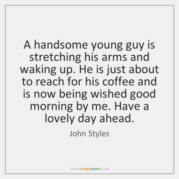A handsome young guy is stretching his arms and waking up. He ...