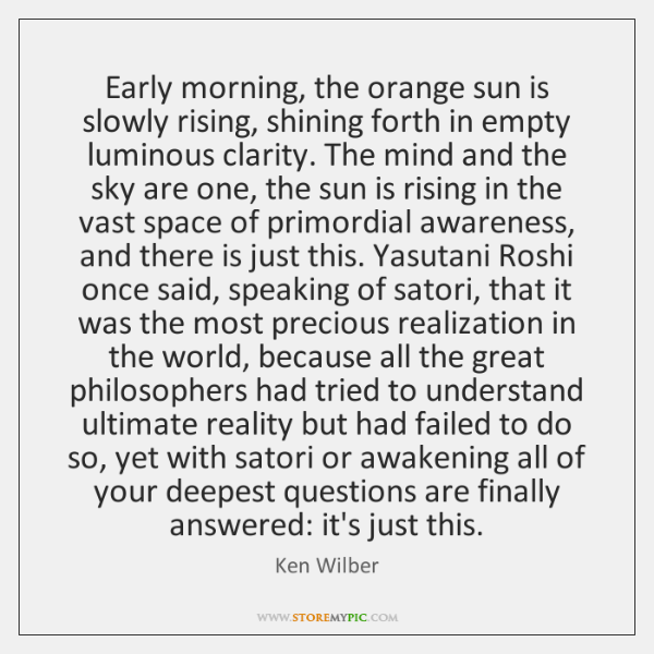 Early morning, the orange sun is slowly rising, shining forth in empty ...