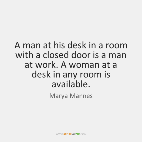A man at his desk in a room with a closed door ...