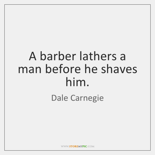 A barber lathers a man before he shaves him.