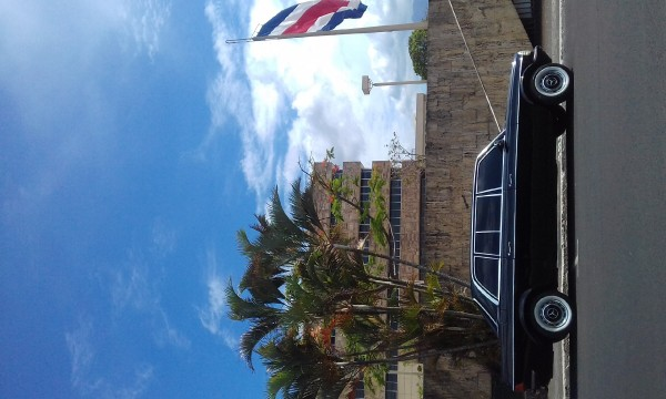COSTA RICA BUILDING WITH A FLAG AND LIMOUSINE